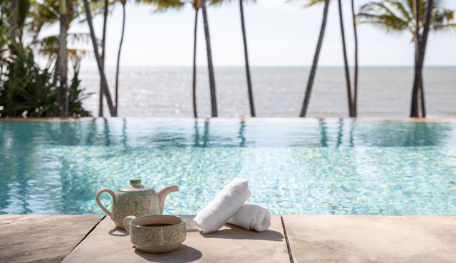 Poolside with Palm Trees and tea at Alamanda Palm Cove by Lancemore